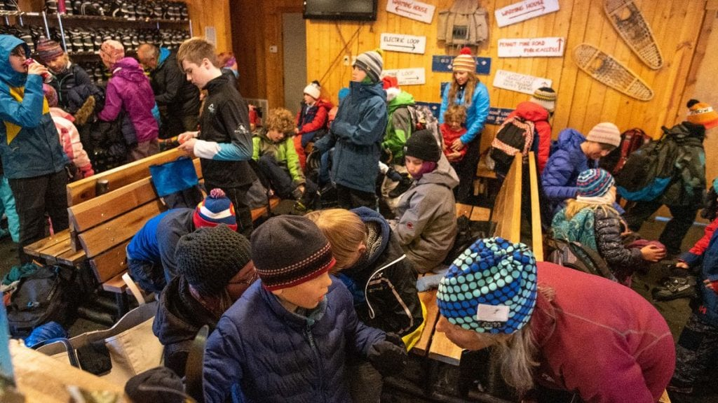 Crested Butte Nordic Center warming house full of youngsters prepping for after school programs