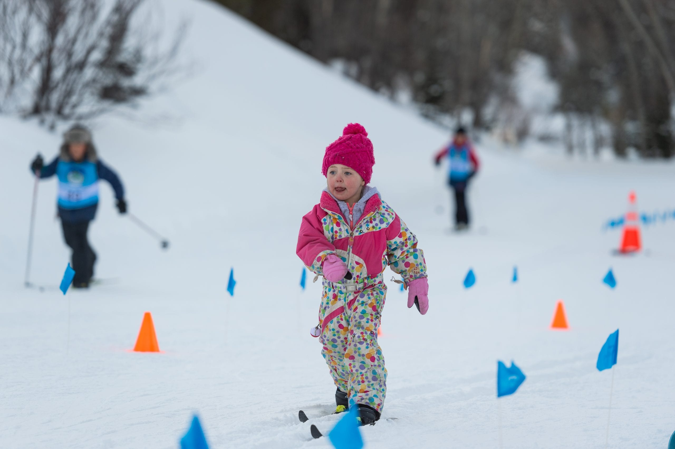 Young skier practicing classic technique in after school program