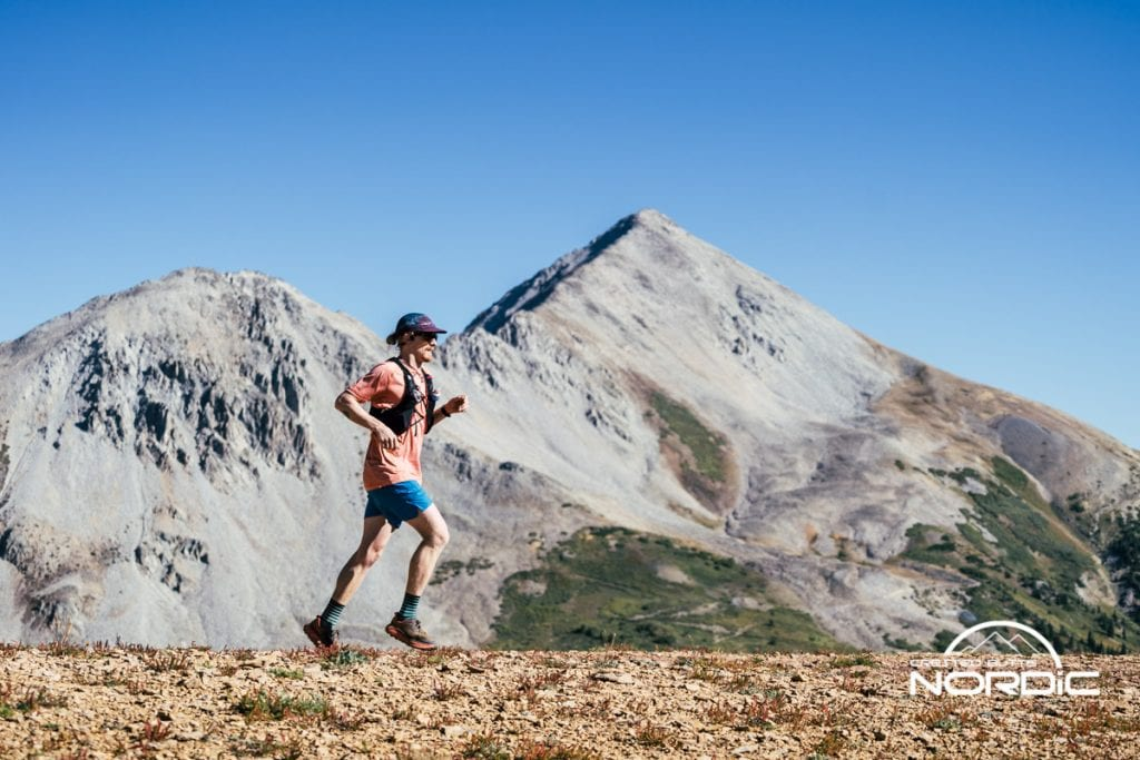 Summer Grand Traverse running competitor on course