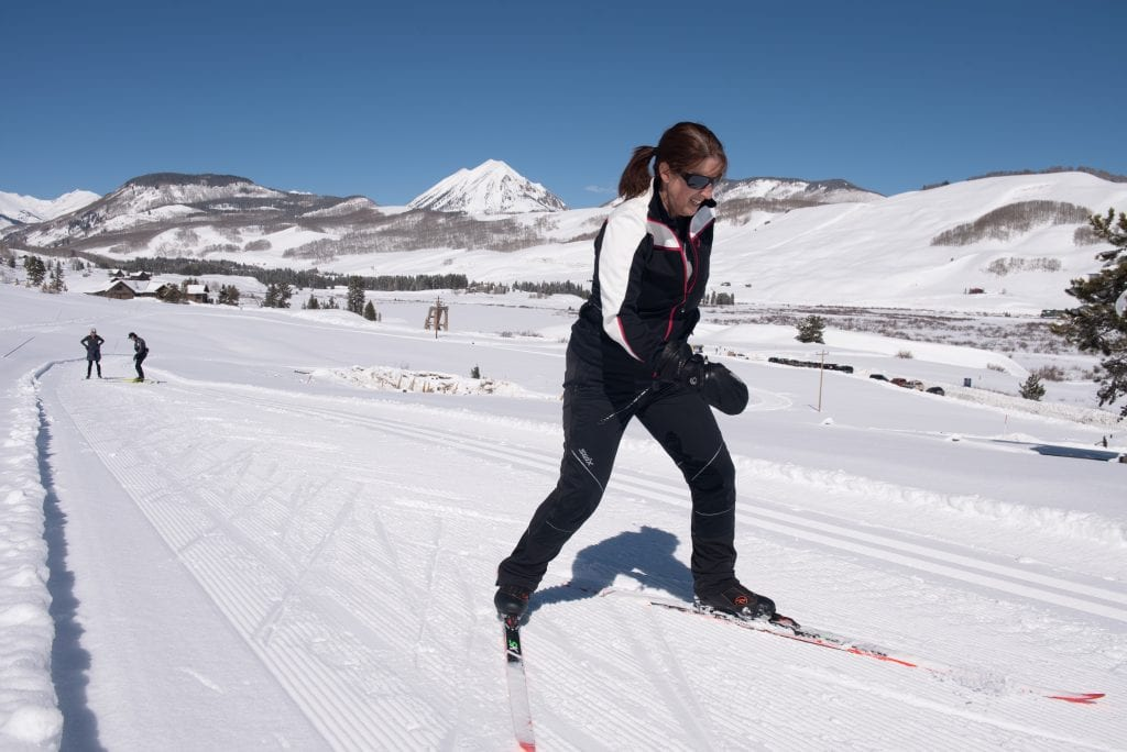 Masters skier working on skills in a clinic