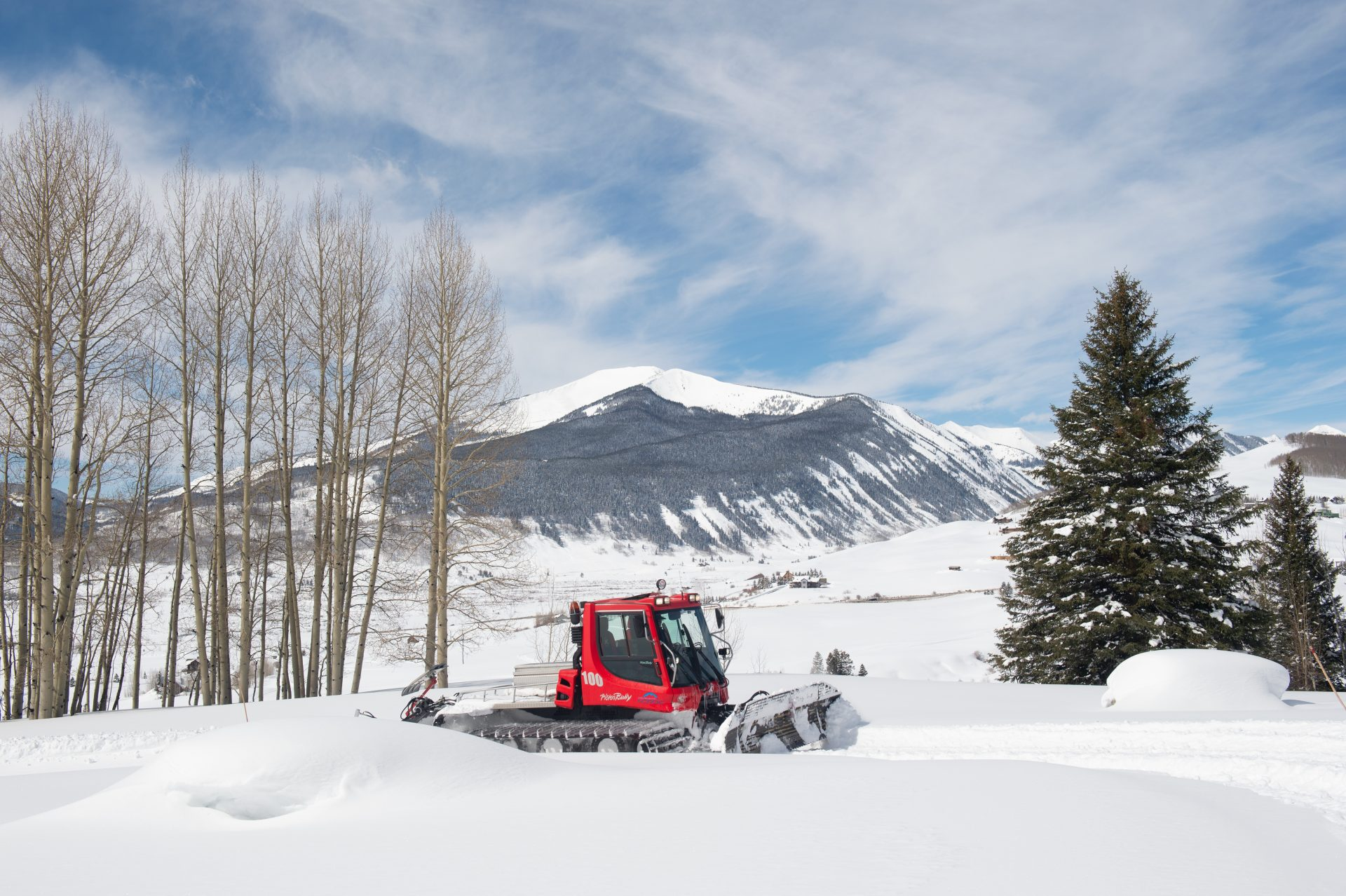 Snow cat grooming trails with Mt Emmons in background