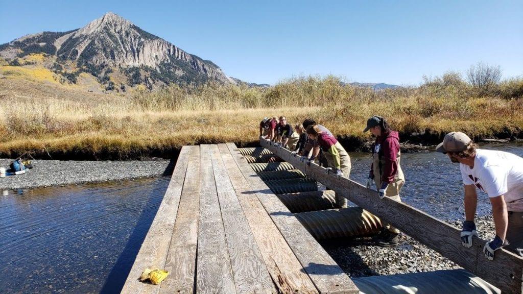 Volunteers building bridges