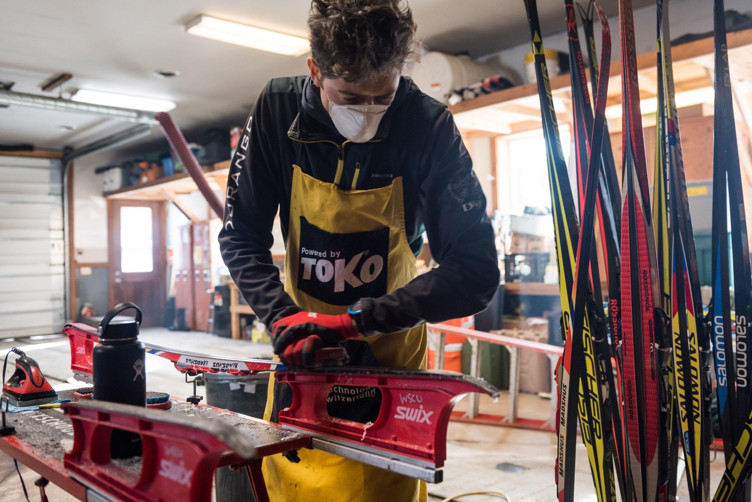 Waxing tech polishing a ski