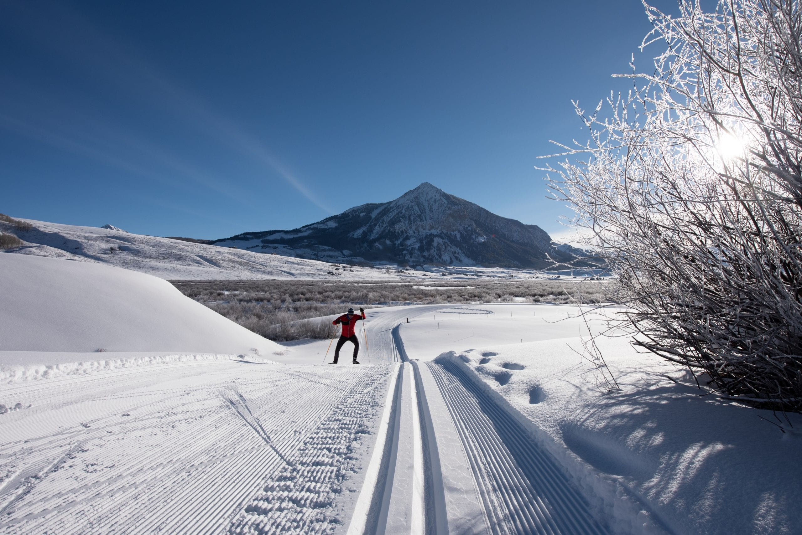 Skate skier with Mt Crested Butte backdrop
