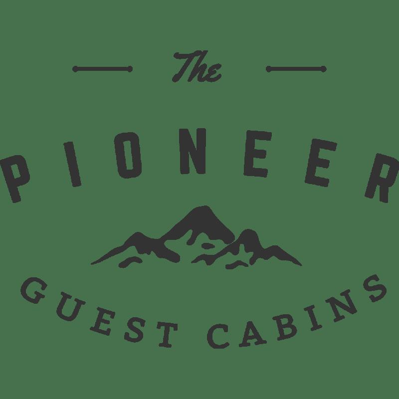 Pioneer Guest Cabins logo