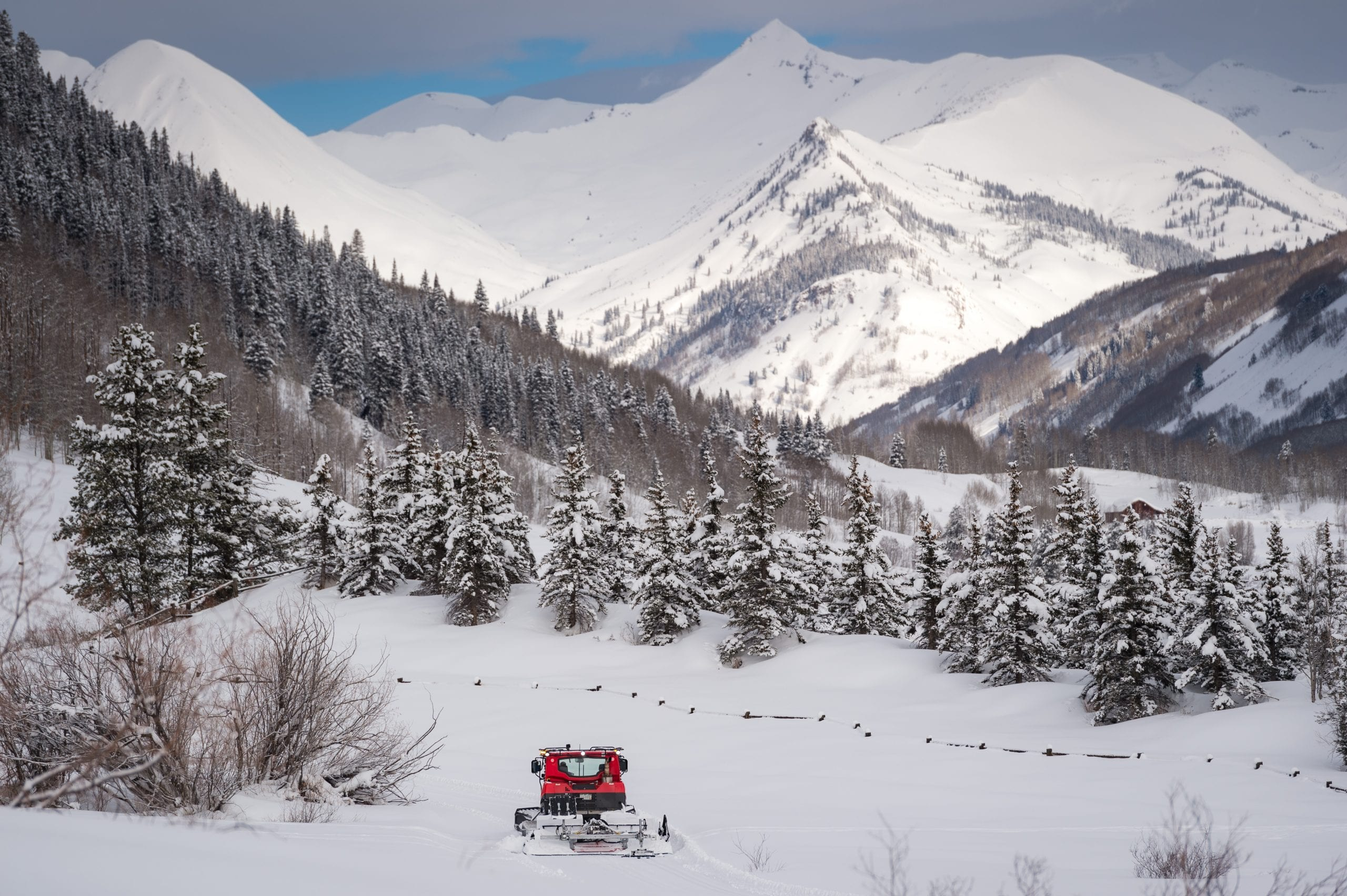 Snow cat grooming CB Nordic trails with Paradise Divide backdrop