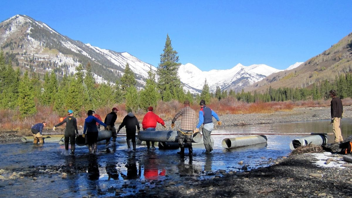 Volunteers helping build bridges for winter trails