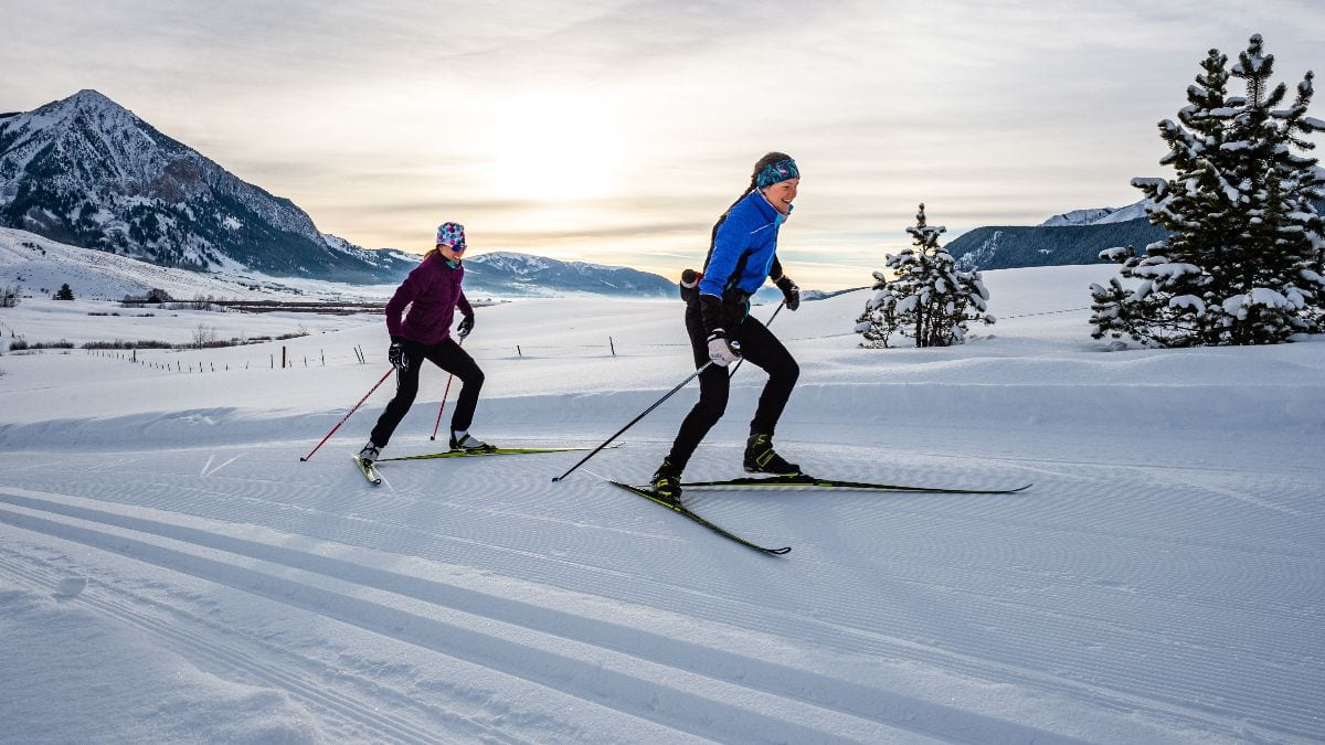 Skate skiers on Magic Meadows trails with Mt Crested Butte backdrop