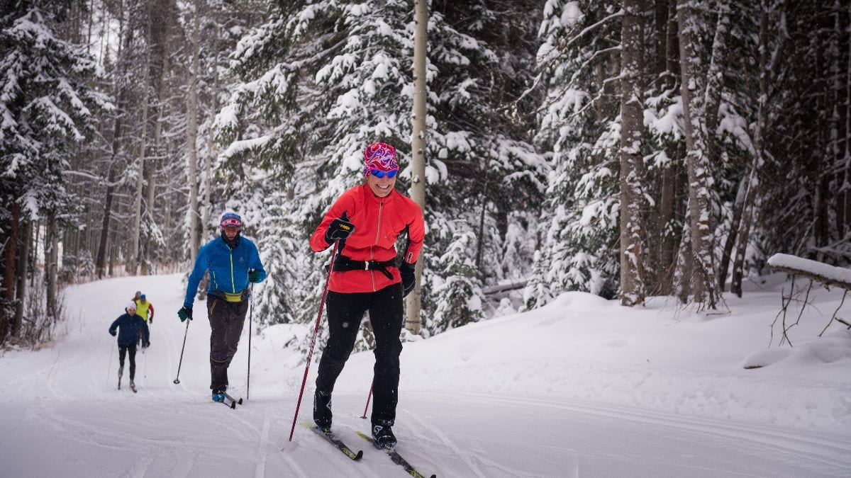 Classic skiers ascending a hill on Ruthie's Run in Crested Butte