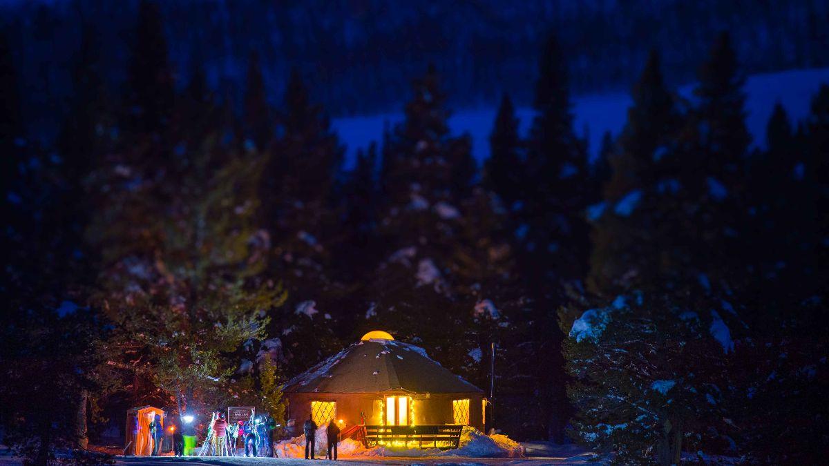 Magic Meadows Yurt lit up at night