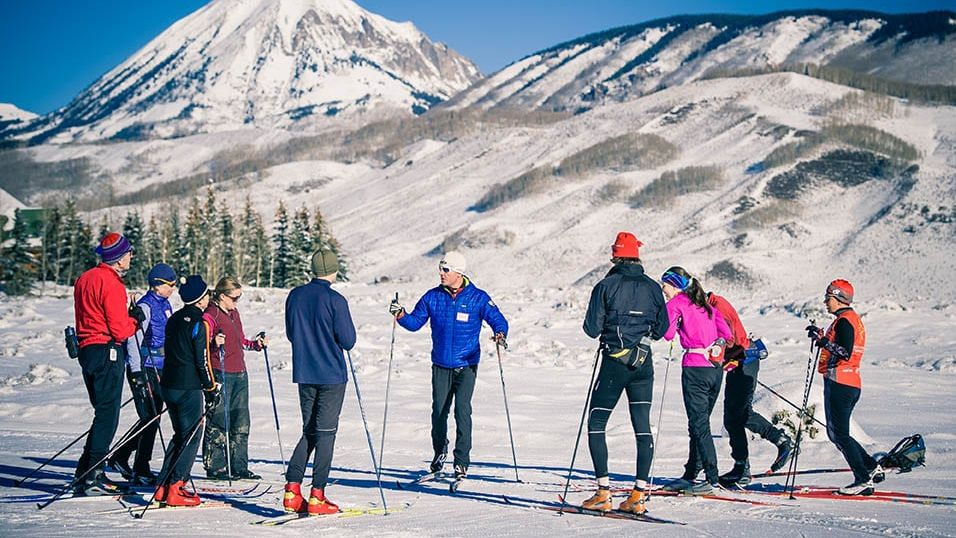 Masters ski clinic near Crested Butte with Gothic Mountain in background